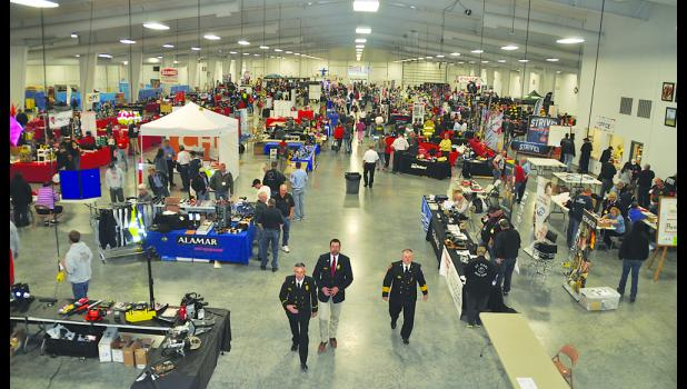 More than 1,300 firefighters took part in Nebraska State Fire School May 20-22 at the state fairgrounds in Grand Island. This view shows the large vendor area before opening ceremonies on May 20. Nebraska Firefighter photo by Jeff Gargano. Fire School committee member Jeff Horn of Fullerton ran the lift to provide the aerial view.