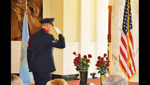 Staff Sergeant Eric Pelissier of the Ellsworth AFB Honor Guard salutes after placing a red rose in a firefighters boot during the annual South Dakota Fallen Firefighters Memorial Service held in Pierre on Sunday, Oct. 12. See more photos and story inside. Photo by Denny Gorton.