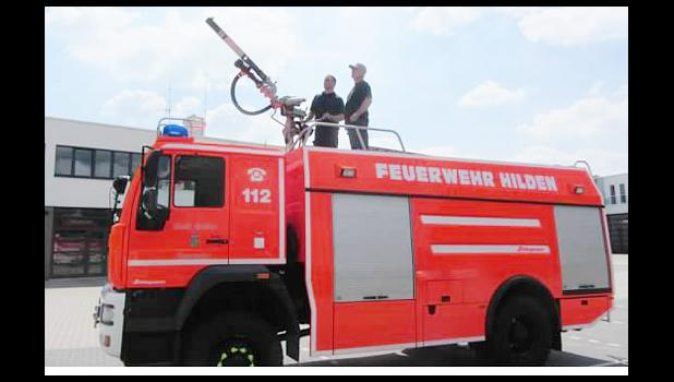 Midland Fire Chief Reuben Vollmer visits with Peter Krings, firefighter/medic in Hilden, Germany.