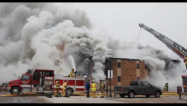 The Spirit Lake Fire Department responded to an apartment building fire that claimed one life on Dec. 7 and left dozens of people homeless. Assisting were fire departments from Arnolds Park/Okoboji, Milford, Superior and Lake Park. Photo by Fire Photographer Tara Yungluth.
